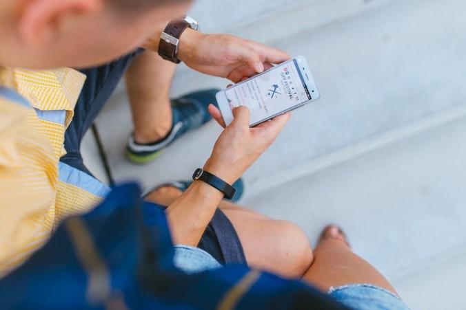 Young Man on Smartphone Millennial Recruitment